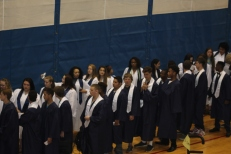 Students line up in the gym, ready to walk to the auditorium. Photo Credit / Frankie Stevens