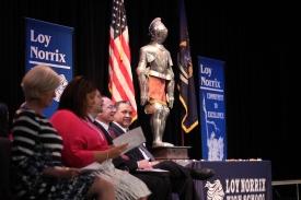 Loy Norrix administrators sit together at candlelight. Photo Credit / Frankie Stevens
