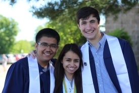 Luis Juarez, Audra Penny and Carsten Strand, the KnightLife editors smile for a photo together. Photo Credit / Frankie Stevens