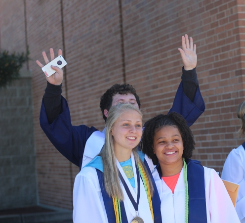 Cutter Olmstead-Meade photo bombs Grace Labadie and SIncere Powell's photo. Photo Credit / Frankie Stevens