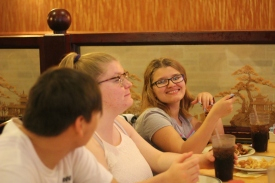 Matthew Rodriguez, Aubrey Leppen, and Alexis England enjoy their food. Photo Credit / Abby Farrer
