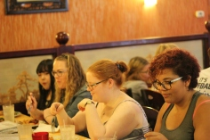 Latharia Smith, Helen Snyder, Katherine Cartwright and Chi Zhang sit down for lunch. Photo Credit / Abby Farrer