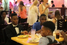 Gregory King and Zaron Tate sit down for a meal after candlelight. Photo Credit / Frankie Stevens