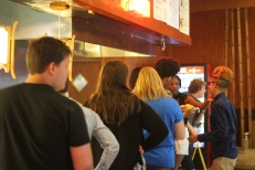 Seniors wait at the grill for their food. Photo Credit / Frankie Stevens