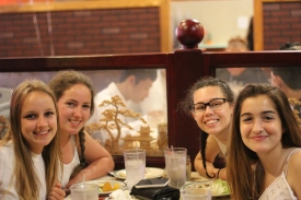 Aude Kuzniak, Lusia Stock, Brooke Washington, and Julia Morera smile for the camera. Photo Credit / Abby Farrer