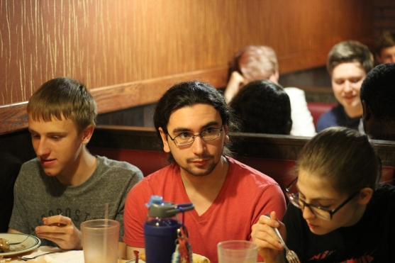 Josh Dunham, Nicolas Augustine, and Rachel Cannon enjoy their meal. Photo Credit / Abby Farrer