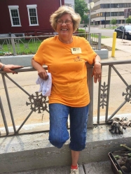 Patricia Pittman lounges outside City Hall in between planting sessions. She helped plant the flowers as well as gave students lessons on how to properly tend the beds. Photo Credit / Rachel Zook