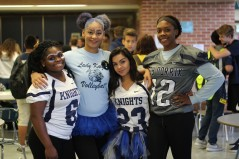 "FRIDAY: Seniors Destiny Mabon, Ashantai Sandifer, Jasminmarie Castaneda, and Morgan Hawkins dressed in blue and white. ""Got to go all out, let's get it,"" exclaimed Sandifer. Photo Credit / Hannah Pittman"