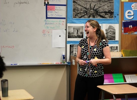 Larner chuckles with students in AP French. She loves teaching and doesn't have a problem showing it. Photo Credit / Zach Liddle