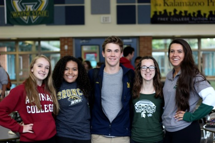 "WEDNESDAY: Seniors Maeve Wilson, Brittany Day, Brendan Feenstra, Sophie Nielson, and Hana Lee dressed in college gear. ""I got my hoodie from Aquinas last year when I visited, the campus was really pretty,"" said Wilson. Photo Credit / Hannah Pittman"