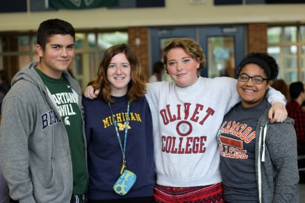WEDNESDAY: Juniors Trentin Hohler, Naomi Verne, Ferren Olmsted, and Rhiannon Pitcock wearing college attire. They are wearing Michigan State and Berkely, Michigan, Olivet, and Kalamazoo College clothes, respectively. Photo Credit / Hannah Pittman