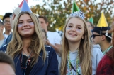 Seniors Hannah Pittman and Maeve Wilson wear birthday party hats in Thursday's student section. The home football game against Gull Lake High School was moved from Friday to Thursday in support for the Loy Norrix players who would be at DQ's funeral that Friday, the 16th. Photo Credit / Michaela Whalen