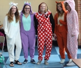 "MONDAY: Sophomores Rebecca Taplin, Kylie Taplin, Karli Little, Katie Schnieder, and freshman Emma Hilgart-Griff show their school spirit in onesies. Hilgart-Griff explained, ""We are all swimmers!"" on the women's swim team. Photo Credit / Hannah Pittman"