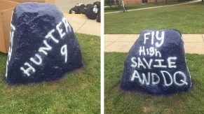 "The Loy Norrix ""spirit rock"" was painted by senior Michaela Whalen and alumni Evan Vanhorne before the football game on September 9th. The rock has been painted throughout the many years of Loy Norrix's history by teams and individuals when something significant is occurring. Photo Credit / Andrew Laboe"