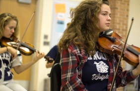 "Senior Lexi Terrian looks on during instruction. ""My favorite thing about orchestra is how each section comes together to make a creative unit that creates beautiful music,"" said Terrian. Photo Credit / Sidney Richardson"