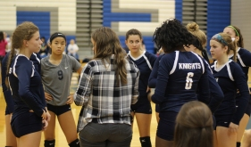 The Junior Varsity Team listened closely during a timeout. Photo Credit / Sidney Richardson