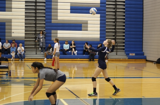 Sophomore Marah Deary serves the ball during their game against Mattawan. Photo Credit / Sidney Richardson