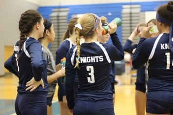 Sophomore Emma Knutson gets water during a timeout. Photo Credit / Sidney Richardson