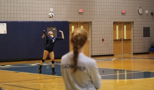Senior Lizzie Ko serves the ball during a game against Mattawan. Photo Credit / Sidney Richardson
