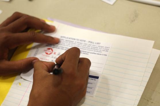 Senior Sidney Richardson fills out his voting affadavit for the mock election. Photo Credit / Christian Baker