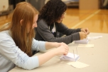 Juniors Tihnae Bennett and Anna Kushner help to run the mock election, they are collecting affadavits and directing voters. Photo Credit / Sidney Richardson