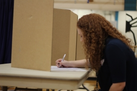 Junior Nikki Russell fills out her ballot for the mock election. Photo Credit / Sidney Richardson