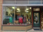 "Handmade Kalamazoo showing off one of their best selling ""Mad Love"" shirts along with many other one of a kind peices of art in the display window. / Photo Credit Joshua Wild"