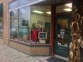 The storefront and entryway of both Handmade Kalamazoo and Ma Zawi grapic design. / Photo Credit Joshua Wild