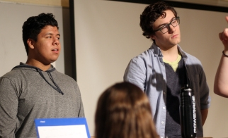 Senior Giovani Diaz and junior Victor Moss focus and practice their scales during rehearsal. Multiple is all acapella, so hitting the correct notes even in the background is imperative. Photo Credit / Sidney Richardson