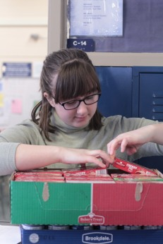 Nooney dedicates hours and hours of her time helping with the food drive. Photo Credit / Emma Whitehead