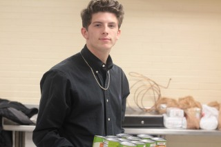 Senior Gabe Runyon leaves his 5th hour to help with the food drive. Photo Credit / Emma Whitehead