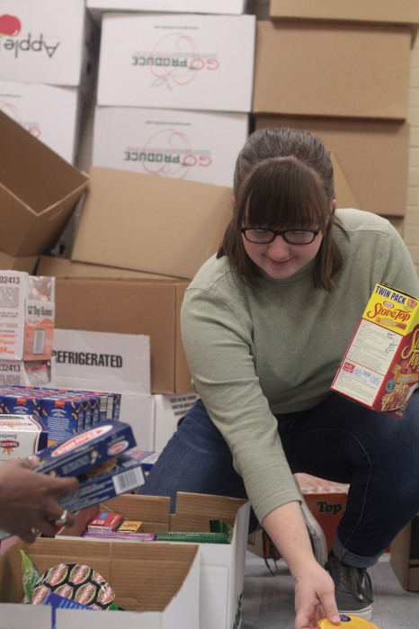 Junior Caeleigh Nooney stays after school to help sort all the food. Photo Credit / Emma Whitehead
