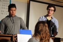 Senior Giovani Diaz and junior Victor Moss work to hit their notes during rehearsal. They are directed by junior Grace Erway on what notes they should be hitting. Photo Credit / Sidney Richardson
