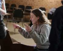 Junior Grace Erway sings and directs the voices of the team. While she does this, she adjusts their pitches and respective notes to make the finished product sound more audibly appealing. Photo Credit / Sidney Richardson