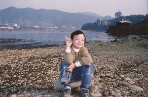 A young Zheng is pictured holding up a peace sign, a symbol both China and The U.S. have in common.