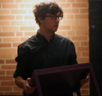 """Junior Victor Moss works on his block movement during rehearsal. Moss often plays the lead in Loy Norrix's Theatrical performances like his role of Conrad Birdie in the musical """"Bye Bye, Birdie."""" Photo Credit / Sidney Richardson"""
