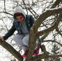Here Alex is climbing a tree and we can see how fun and adventurous he was.