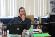 Teacher John Kreider smirks, making jokes with students. Kreider always engages with leaders. Photo Credit / Meghan Lewis