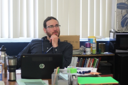 Teacher John Kreider smirks, making jokes with students. Kreider always engages with leaders. Photo Credit / Meghan Lewis