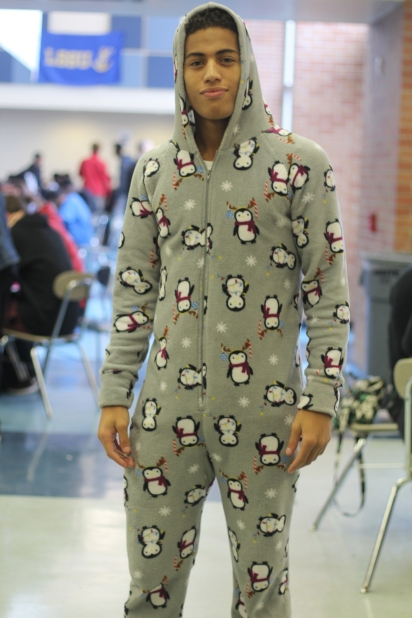 "Senior Cameron Flowers cozies up for pajama day, Thursday's spirit week theme. ""I like penguins so much because they are kinda like me, half black and half white, sometimes walk funny and love seafood,"" said Flowers. Photo Credit / Michaela Whalen"