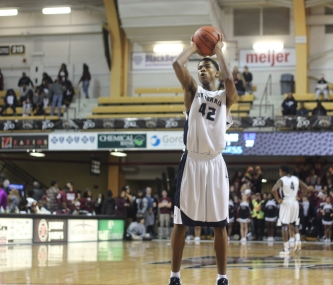 Sophomore Deandre Worthy takes his free-throw shot during the 4th quarter of Loy Norrix's winterfest basketball game Friday, January 20th. Loy Norrix went on to lose 93-51 to Kalamazoo Central. Photo Credit / Michaela Whalen