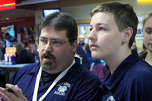 Coach Mike Brandt coaches his son, junior Bailey Brandt, during a game. Bailey is in his third year on the team. Photo Credit / Joey Welch