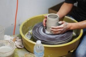 Mora (Church's Wife) working on a handmade mug. Photo Credit / Josh WIld