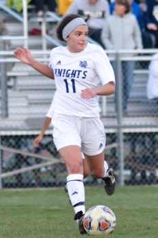 Senior Maria Egloff plays center mid field. She has played for the Knights soccer team all four years. The Knights lost to Mattawan 1-0. Photo Credit / Deanna Puca