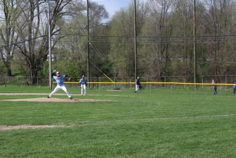 Senior Duncan Wallis pitches the ball. Varsity baseball ended up losing against the homeschool team that day.