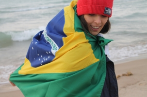 Isabela Seixas, a 18 year old exchange student from Brazil is proudly using her flag to warm her up in her host town Saint Joseph. Seixas has enjoyed her year in U.S. but her love and value of her home country has grown a lot. Photo Credit / Sarita Nieminem