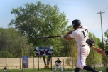 Senior Bruce Allen makes contact with the ball during extra innings. The Knights go on to win off of an RBI double.