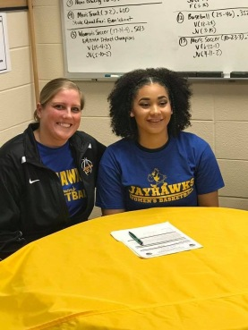 "Ashantai Hale-Sandifer signed in the athletic office with her family and future coach, she will be playing basketball in Muskegan Community college. ""Well one, my friends plays there and two, it's a place I've never really been before and so like going somewhere new and starting a new chapter in my life,"" said Hale-Sandifer. Photo Credit / Leslie Sandifer"