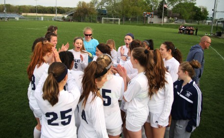 The women's varsity soccer team participates in their pre-game cheer. They defeated Kalamazoo Central 2-1.
