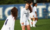 Sophomore defender Maeve Novotny, and freshman defender Addy Alexopoulos share a laugh seconds before the start of the game.